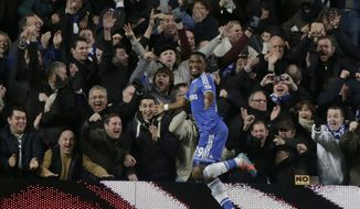 Chelsea's Samuel Eto'o, left, celebrates after his hat-trick against Manchester United during the English Premier League soccer match between Chelsea and Manchester United at Stamford Bridge stadium in London, Sunday, Jan. 19, 2014. (AP Photo/Matt Dunham)