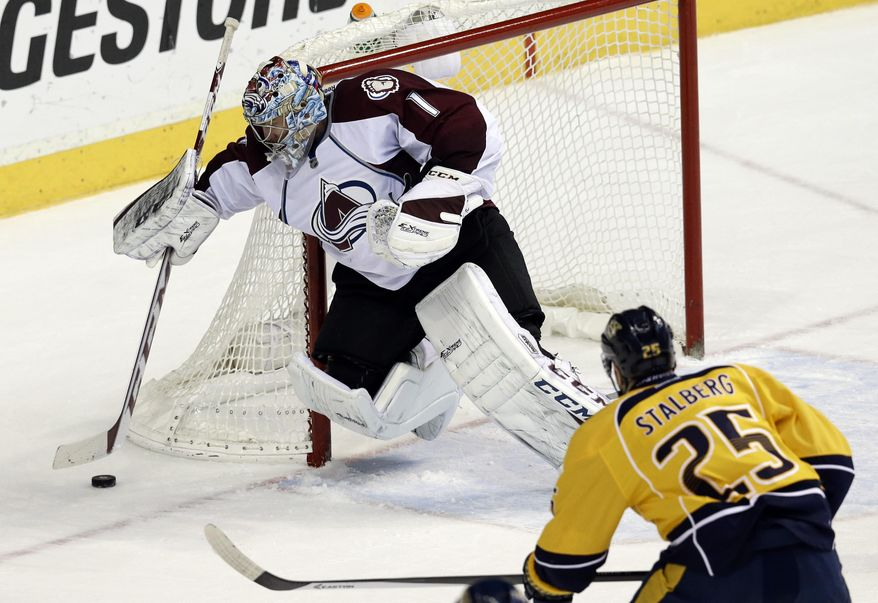 Colorado Avalanche goalie Semyon Varlamov (1), of Russia, covers up the puck as Nashville Predators forward Viktor Stalberg (25), of Sweden, closes in during the second period of an NHL hockey game, Saturday, Jan. 18, 2014, in Nashville, Tenn. (AP Photo/Mark Humphrey)
