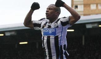 Newcastle United's Loic Remy celebrates his goal against  West Ham United during their English Premier League soccer match at Upton Park, London, Saturday, Jan. 18, 2014. (AP Photo/Sang Tan)