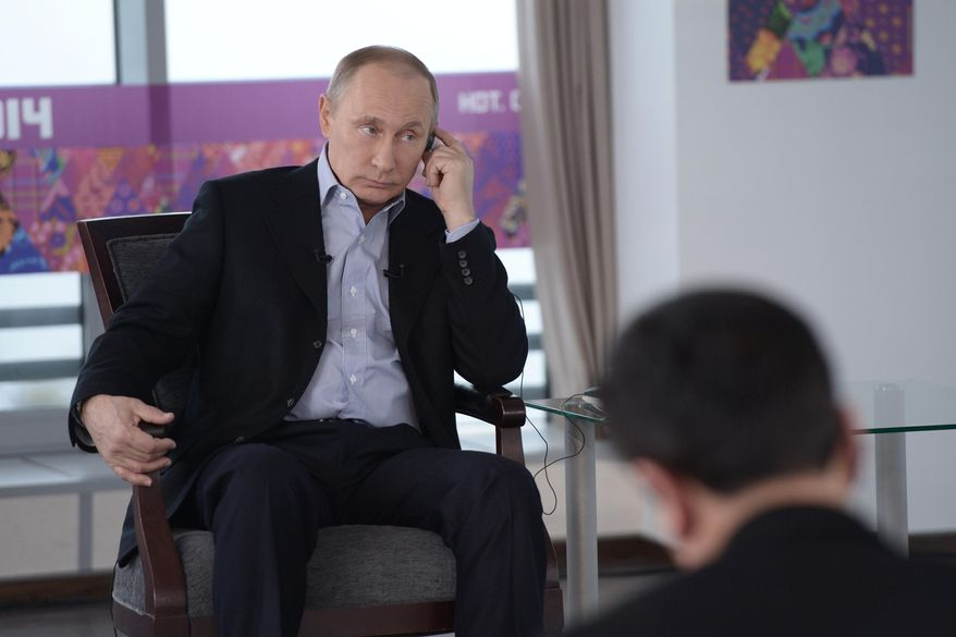 In this Friday, Jan. 17, 2014, photo made available by Presidential Press Service on Sunday, Jan. 19, 2014, Russian President Vladimir Putin listens to a translation during an interview to Russian and foreign media at the Russian Black Sea resort of Sochi, which will host Winter Olympic Games on Feb.  7, 2014. (AP Photo/RIA Novosti, Alexei Nikolsky, Presidential Press Service)