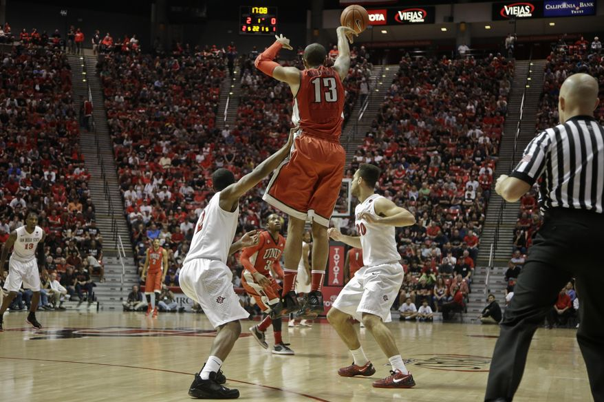 UNLV guard Bryce Dejean-Jones (13) beats the San Diego State press as he passes downcourt during the first half of an NCAA college basketball game on Saturday, Jan. 18, 2014, in San Diego. (AP Photo/Lenny Ignelzi)