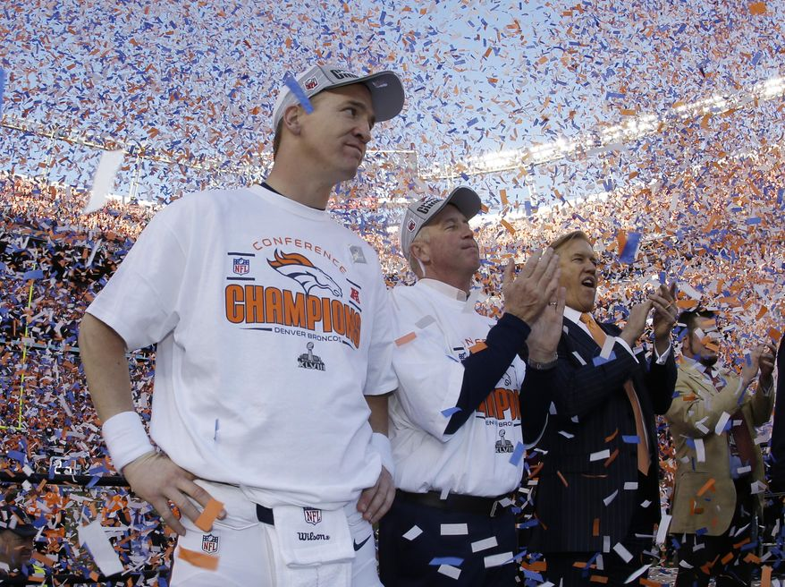 Denver Broncos quarterback Peyton Manning, stands with Broncos' head coach  John Fox and Broncos VP John Elway during the trophy ceremony after the AFC Championship NFL playoff football game in Denver, Sunday, Jan. 19, 2014. The Broncos defeated the Patriots 26-16 to advance to the Super Bowl. (AP Photo/Charlie Riedel)