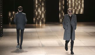 Models present creations as part of French born fashion designer Hedi Slimane for Saint Laurent men's Fall-Winter 2014-2015 fashion collection, presented Sunday, Jan. 19, 2014 in Paris. (AP Photo/Christophe Ena)