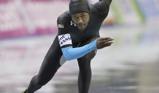 Shani Davis of the United states skates in the men's 1,000-meter race of the World Sprint Speed Skating Championships in Nagano, central Japan, Sunday, Jan. 19, 2014. (AP Photo/Koji Sasahara)