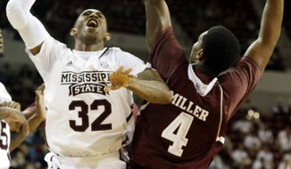 Mississippi State guard Craig Sword (32) shoots past the defense of Texas A&M forward Tavario Miller (4) in the first half of an NCAA college basketball game in Starkville, Miss., Saturday, Jan. 18, 2014.  (AP Photo/Rogelio V. Solis)
