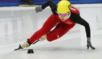 FILE- China's Wang Meng skates during women's 500-meter race at the World Cup short track speedskating championship in the Iceberg skating arena in the Black Sea resort of Sochi, Russia, in this file photo dated Saturday, Feb. 2, 2013.  Wang Meng, China's most decorated Winter Olympian, broke her ankle in training and will likely miss the Sochi Games, after she collided with a teammate on a turn on Thursday. Ang Meng underwent surgery within hours of the incident, said Liu Hao, the China team's deputy short track manager. (AP Photo/Igor Yakunin, FILE)