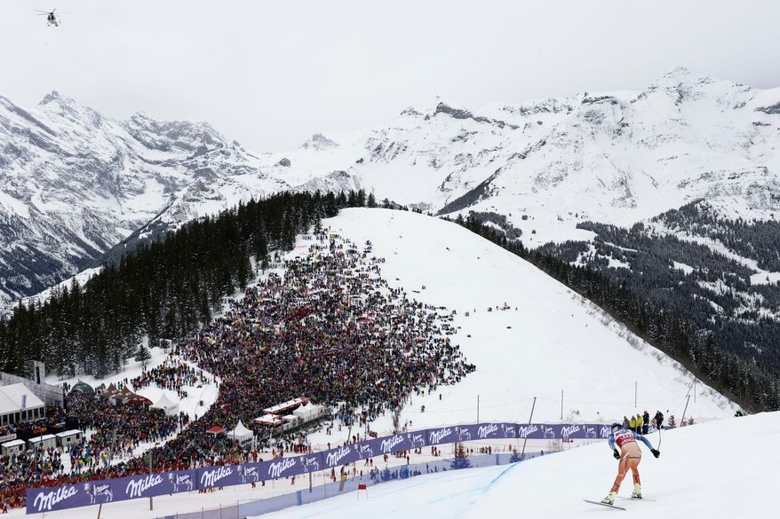 Norway's Aksel Lund Svindal speeds down the course during the Alpine skiing World Cup downhill race at the Lauberhorn in Wengen, Switzerland, Saturday, Jan. 18, 2014. (AP Photo/Keystone, Jean-Christophe Bott)