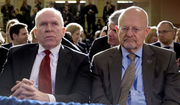 Director of National Intelligence James Clapper, right, and CIA Director John Brennan, left, sit in the front row before President Barack Obama spoke about National Security Agency (NSA) surveillance, Friday, Jan. 17, 2014, at the Justice Department in Washington. (AP Photo/Carolyn Kaster) ** FILE **
