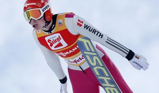 Germany's Eric Frenzel soars through the air during the ski jumping portion on the final day of the Nordic Combined triple World Cup in Seefeld, Austria, Sunday, Jan.19, 2014. (AP Photo/Michael Probst)