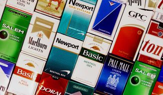** FILE ** This Sept. 14, 2005, file photo shows packs of cigarettes in a store in Brunswick, Maine. (AP Photo/Pat Wellenbach, File)