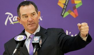 New Minnesota Vikings head coach Mike Zimmer answers a question during an NFL football media availability at Winter Park in Eden Prairie, Minn., Friday, Jan. 17, 2014. (AP Photo/Ann Heisenfelt)