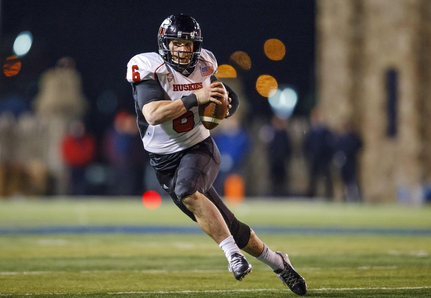 FILE - In this Nov. 20, 2013, file photo, Northern Illinois quarterback Jordan Lynch (6) runs the ball against Toledo during the second quarter of an NCAA college football game in Toledo, Ohio. For  Lynch, this weekend's East-West Shrine game is another opportunity to show he's a better pro prospect than some scouts might suspect. (AP Photo/Rick Osentoski, File)