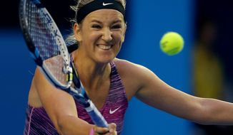 Victoria Azarenka of Belarus hits a forehand return to Yvonne Meusburger of Austria during their third match at the Australian Open tennis championship in Melbourne, Australia, Saturday, Jan. 18, 2014.(AP Photo/Aaron Favila))