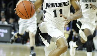 Providence guard Bryce Cotton (11) dribbles on his way to making a basket against Creighton during the second half of an NCAA college basketball game on Saturday, Jan. 18, 2014, in Providence, R.I. Providence defeated Creighton 81-68. (AP Photo/Stew Milne)