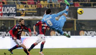 Napoli's Gonzalo Higuain goes for an acrobatic kick during a Serie A soccer match between Bologna and Napoli at the Renato Dall'Ara stadium in Bologna, Italy, Sunday, Jan. 19, 2014. (AP Photo/Studio FN)