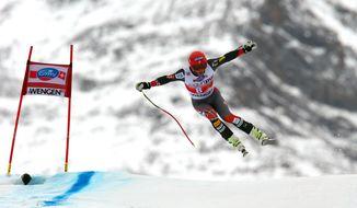 Bode Miller, of the United States, is airborne during an alpine ski, men's World Cup downhill, in Wengen, Switzerland, Saturday, Jan. 18, 2014. (AP Photo/Alessandro Trovati)