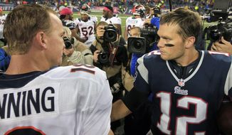 In this Oct. 7, 2012, file photo, Denver Broncos quarterback Peyton Manning, left, and New England Patriots quarterback Tom Brady, right, speak in the middle of the field after the Patriots beat the Broncos 31-21 in an NFL football game in Foxborough, Mass. (AP Photo/Steven Senne, File)