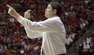 UNLV coach Dave Rice points during the first half of an NCAA college basketball game against San Diego State, Saturday, Jan. 18, 2014, in San Diego. (AP Photo/Lenny Ignelzi)