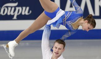 Israel's Andrea Davidovich and Evgeni Krasnopolski compete in the pairs free skating at the European Figure Skating Championships in Budapest, Hungary, Sunday, Jan. 19, 2014. (AP Photo/Darko Bandic)