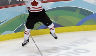 FILE - In a Feb. 28, 2010, file photo Canada's Sidney Crosby  leaps in the air  after making the game-winning goal in the overtime period of a men's gold medal ice hockey game against USA at the Vancouver 2010 Olympics in Vancouver, British Columbia.  Crosby will captain the Canadian hockey team at the Olympics in Sochi.   (AP Photo/Chris O'Meara, file)