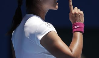 Li Na of China appeals a point as she plays Lucie Safarova of the Czech Republic  during their third round match at the Australian Open tennis championship in Melbourne, Australia, Friday, Jan. 17, 2014.(AP Photo/Rick Rycroft)