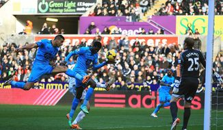 Tottenham Hotspur's Emmanuel Adebayor, centre, prior to scoring his team's opening goal, during the English Premier League soccer match against Swansea City,  at the Liberty Stadium, Swansea, Wales, Sunday Jan. 19, 2014. (AP Photo/PA, Nick Potts) UNITED KINGDOM OUT