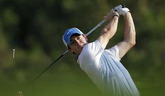 Rory McIlroy of Northern Ireland tees off on the 16th hole during the 2nd round of the Abu Dhabi HSBC Golf Championship in Abu Dhabi, United Arab Emirates, Friday Jan. 17, 2014. (AP Photo/Kamran Jebreili)