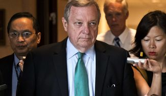 "FILE - This Sept. 4, 2013 file photo shows Sen. Dick Durbin, D-Ill., at the Capitol in Washington. During a speech at a breakfast honoring Rev. Martin Luther King Friday, Jan. 17, 2014 in Chicago, Durbin told attendees he's working with Illinois lawmakers to raise the state's $8.25 hourly rate. Pushing for an increase is a Democratic strategy nationwide. He then blasted Republican gubernatorial candidate Bruce Rauner for being ""out of touch"" on the issue. (AP Photo/J. Scott Applewhite, File)"