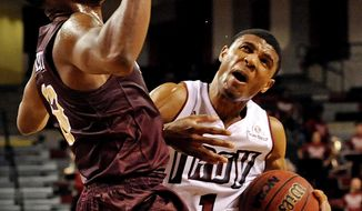 Troy guard Antoine Myers (1) drives past Louisiana-Monroe guard Chinedu Amajoyi (13) during the second half of an NCAA college basketball game in Troy, Ala., Thursday, Jan. 16, 2014. Myers was called for an offensive foul on the play. Louisiana-Monroe won 75-64. (AP Photo/The (Troy) Messenger, Thomas Graning)