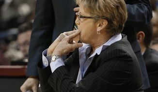 Tennessee coach Holly Warlick whistles to her team during the second half of an NCAA college basketball game against Mississippi State in Starkville, Miss., Thursday, Jan. 16, 2014. Tennessee won 67-63. (AP Photo/Rogelio V. Solis)