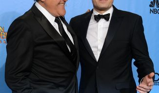 "File- This Jan. 13, 2013, file photo shows presenters Jimmy Fallon, left, and Jay Leno posing backstage at the 70th Annual Golden Globe Awards at the Beverly Hilton Hotel  in Beverly Hills, Calif. Leno will close out his 22-year run as host of NBC's ""The Tonight Show"" with a nod to the future and to the past. His heir apparent, Fallon, will kick off Leno's final week with a guest appearance on Feb. 3. Fallon is taking over the gig after hosting NBC's ""Late Night"" since 2009. (Photo by Jordan Strauss/Invision/AP)"