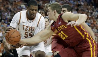 Iowa State's Matt Thomas (21) pressures Texas' Cameron Ridley (55) during the first half on an NCAA college basketball game, Saturday,  Jan. 18, 2014, in Austin, Texas. (AP Photo/Eric Gay)
