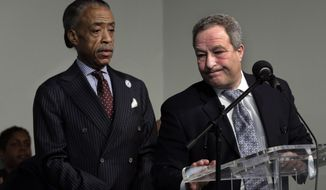 David Perecman, right, attorney for Vanessa Fontaine, mother of missing autistic teen Avonte Oquendo, speaks at the Rev. Al Sharpton's National Action Network headquarters, in New York,  Saturday, Jan. 18, 2014.  Police were investigating whether human remains found along the shore of New York City's East River could be those of an autistic teen who walked out of his school and vanished more than three months ago, a law enforcement official said Friday. Sharpton is at left.(AP Photo/Richard Drew)