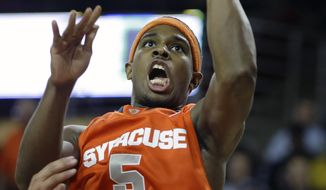 Syracuse forward C.J. Fair (5) shoots during the second half of an NCAA college basketball game against Boston College in Boston, Monday, Jan. 13, 2014. Syracuse 69-59. (AP Photo/Stephan Savoia)