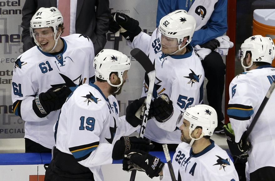 San Jose Sharks' Joe Thornton (19) is congratulated by teammates Justin Braun (61) and Matt Irwin (52) after scoring a goal during the second period of an NHL hockey game against the Florida Panthers, Thursday, Jan. 16, 2014, in Sunrise, Fla. (AP Photo/Lynne Sladky)