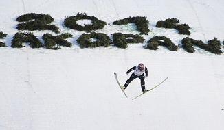 Norway's winner Anders Bardal soars through the air during the ski jumping World Cup in Zakopane, Poland, Sunday, Jan. 19, 2014. (AP Photo/Czarek Sokolowski)