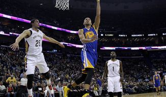 Golden State Warriors point guard Stephen Curry (30) drives past New Orleans Pelicans shooting guard Austin Rivers (25) and point guard Tyreke Evans (1) during the first half of an NBA basketball game in New Orleans, Saturday, Jan. 18, 2014. (AP Photo/Jonathan Bachman)