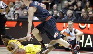 Utah's Parker Van Dyke (5) drives up court after a steal as Southern California's Pe'Shon Howard (10) watches during the first half during an NCAA college basketball game Thursday, Jan. 16, 2014, in Salt Lake City. (AP Photo/Rick Bowmer)