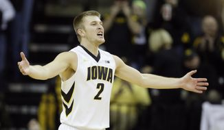 Iowa guard Josh Oglesby reacts after making a 3-point basket during the first half of an NCAA college basketball game against Minnesota, Sunday, Jan. 19, 2014, in Iowa City, Iowa. (AP Photo/Charlie Neibergall)