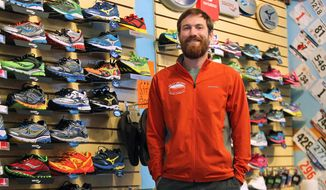 ADVANCE FOR SUNDAY JAN. 19 AND THEREAFTER - This Thursday Jan. 9, 2014 photo shows Robert Smith, the owner of Robert's Running and Walking Shop in Huntington, W.Va. Robert's Running and Walking Shop was just named one of the top 50 running stores in the country.  (AP Photo/The Herald-Dispatch, Lori Wolfe)
