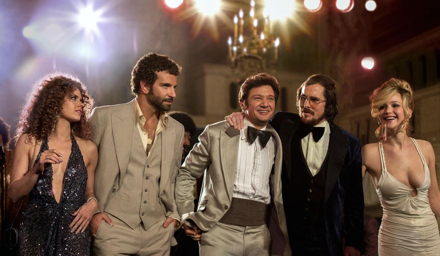 "This film image released by Sony Pictures shows, from left, Amy Adams, Bradley Cooper, Jeremy Renner, Christian Bale and Jennifer Lawrence in a scene from ""American Hustle."" The film was nominated for 10 awards, including an Academy Award for best picture, on Thursday, Jan. 16, 2014. The 86th Academy Awards will be held on March 2. (AP Photo/Sony - Columbia Pictures, Francois Duhamel)"
