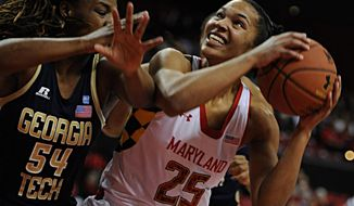 Maryland's Alyssa Thomas (25) looks to shoot as Georgia Tech's Roddreka Rogers defends in the first half of an NCAA college basketball game on Sunday, Jan 19, 2014, in College Park, Md. (AP Photo/Gail Burton)