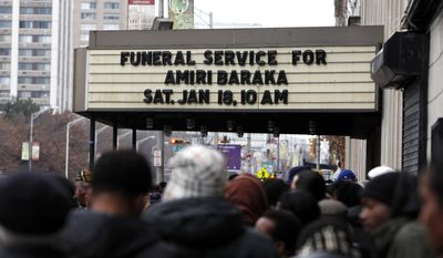 Mourners wait outside before entering the funeral of poet Amiri Baraka,  Saturday, Jan. 18, 2014, in Newark, N.J.  The 79-year-old author of blues-based poems, plays and criticism died Jan. 9 of an undisclosed illness.  (AP Photo/Jason DeCrow)