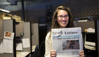 The Lanthorn's Editor-in-Chief, Lizzy Balboa, holds a copy of the paper in the newsroom in the Kirkhof Center at Grand Valley State University on Friday, Jan. 17, 2014. The student-run newspaper has caused a stir on campus after questioning the university's policy of naming rooms and buildings after donors. (AP Photo/ MLive.com, Lauren Petracca)