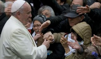 Pope Francis greets people as he arrives at the Sacro Cuore Basilica in Rome, Sunday, Jan. 19, 2014. (AP Photo/Alessandra Tarantino)