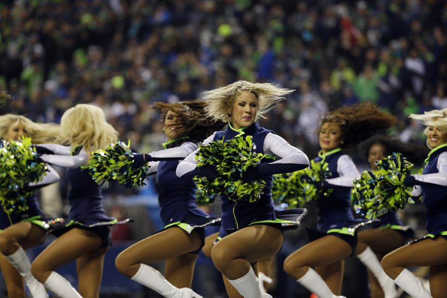Seattle Seahawks cheerleaders perform during the first half of the NFL football NFC Championship game against the San Francisco 49ers Sunday, Jan. 19, 2014, in Seattle.  (AP Photo/Matt Slocum)
