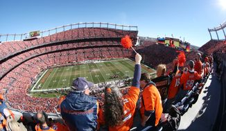 Denver Broncos fans show support in Sports Authority Field at Mile High stadium for the start of the AFC Championship NFL football game as the Broncos host the New England Patriots in Denver on Sunday, Jan. 19, 2014. (AP Photo/David Zalubowski)