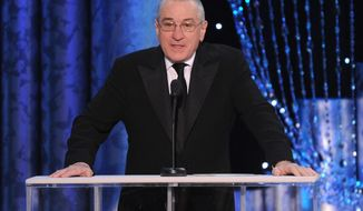 """FILE - In a Saturday, Jan. 18, 2014 file photo, Robert De Niro speaks on stage at the 20th annual Screen Actors Guild Awards at the Shrine Auditorium, in Los Angeles. De Niro has made a documentary about his father, abstract expressionist painter Robert De Niro Sr., called """"Remembering the Artist Robert De Niro Sr,"""" which premiered at Sundance Film Festival and will air on HBO in June.  (Photo by Frank Micelotta/Invision/AP)"""