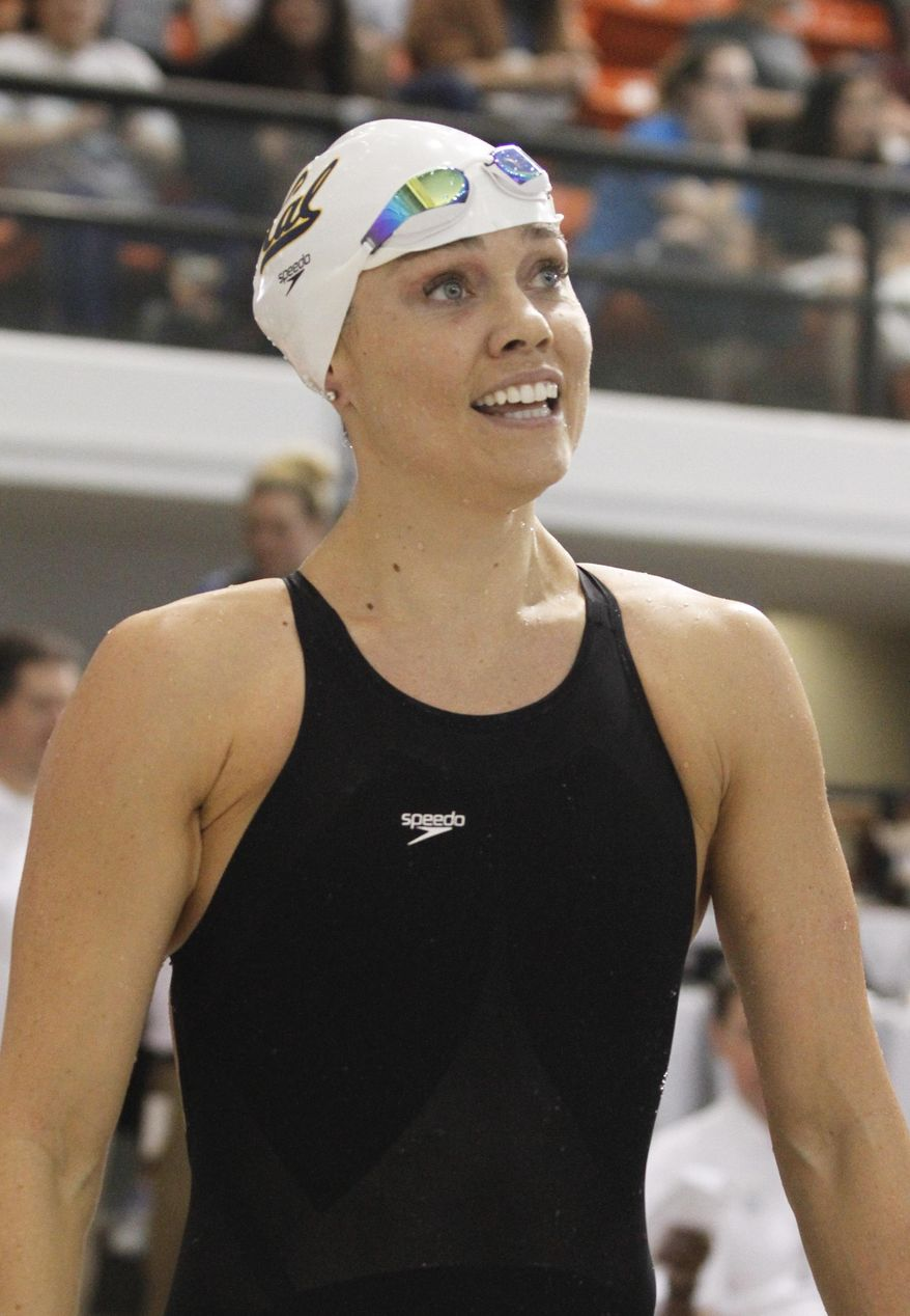 Natalie Coughlin looks at her time following the women's 50-meter freestyle final at the Austin Grand Prix, Saturday, Jan. 18, 2014, in Austin, Texas. Coughlin won the event with a time of 25.17 seconds. (AP Photo/Jack Plunkett)