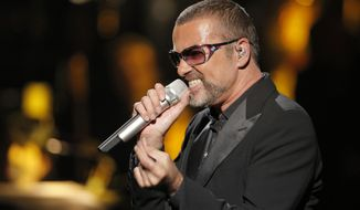 """FILE- British singer George Michael in concert to raise money for AIDS charity Sidaction, in Paris, France, in this file photo dated Sunday, Sept. 9, 2012.  After a spell of making headlines for mishaps rather than music, Michael announced Monday Jan. 20, 2014, that his sixth solo album, """"Symphonica,"""" is due for release March 17, 2014.(AP Photo/Francois Mori, FILE)"""